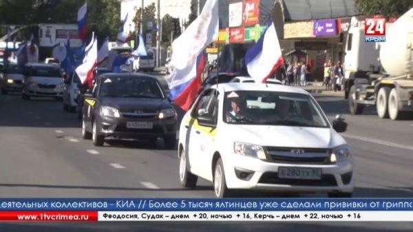 День Государственного герба и флага Республики начался с автопробега