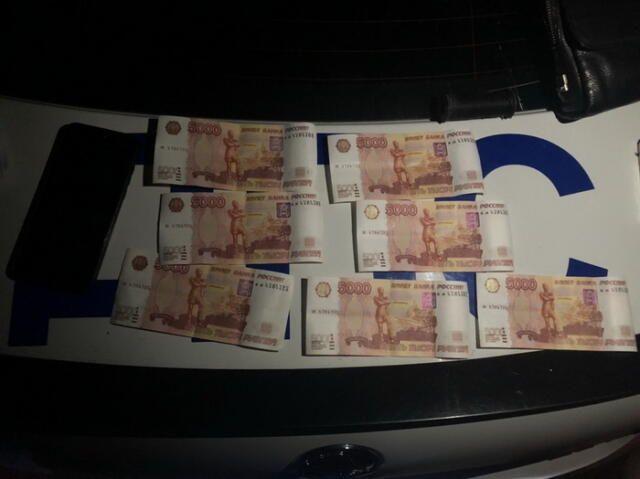 Житель Воронежа собирался сбыть в Симферополе фальшивые деньги
